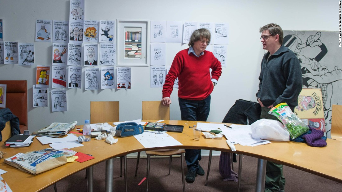 Cabut and Charbonnier talk in the magazine's editorial office in 2012.