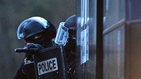 Armed French police patrol in Longpont, north of Paris, France, Thursday, Jan. 8, 2015.