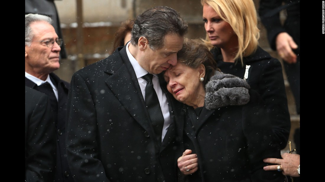 "New York Gov. Andrew Cuomo comforts his mother, Matilda, on Tuesday, January 6, as he watches his father's casket depart St. Ignatius Loyola Church in New York City. Former New York Gov. <a href=""http://www.cnn.com/2015/01/01/politics/gallery/mario-cuomo/index.html"" target=""_blank"">Mario Cuomo</a> died Thursday, January 1, at the age of 82."