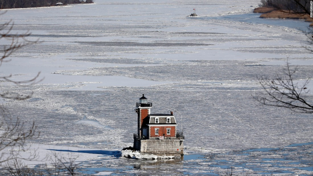 The Hudson-Athens Lighthouse is surrounded by the icy waters of the Hudson River on January 8 in Hudson, New York.
