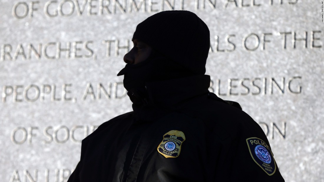 "A police officer stands outside the federal courthouse in Boston on Monday, January 5. <a href=""http://www.cnn.com/2015/01/05/justice/tsarnaev-trial-starts-things-to-know/index.html"" target=""_blank"">It was the first day</a> in the trial of Boston Marathon bombing suspect Dzhokhar Tsarnaev."