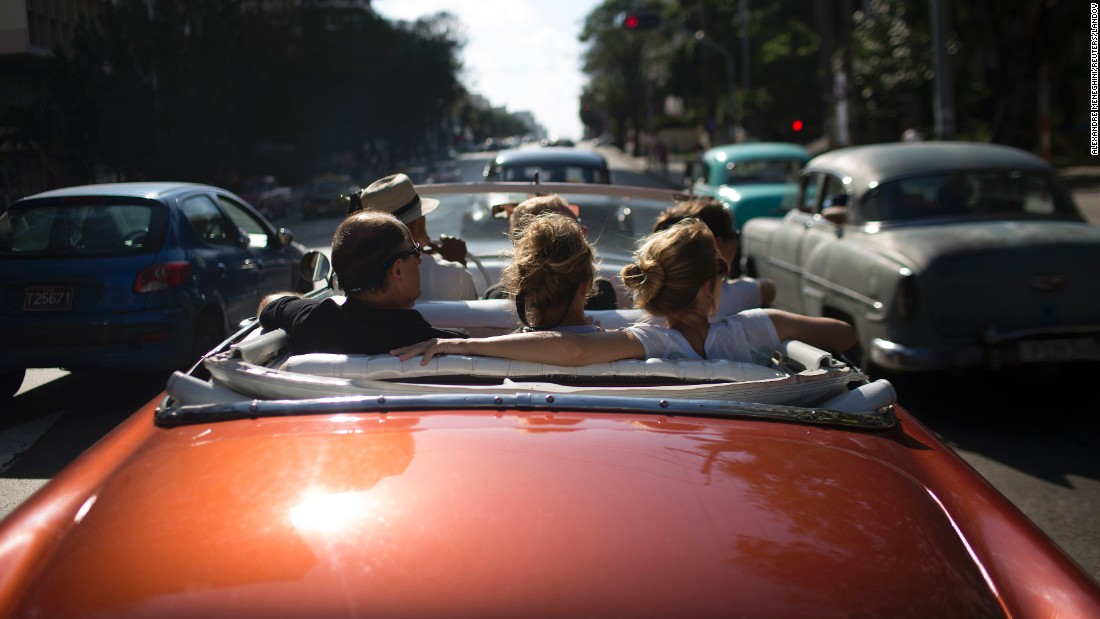 Tourists ride in a convertible in Havana, Cuba, on Tuesday, January 6.