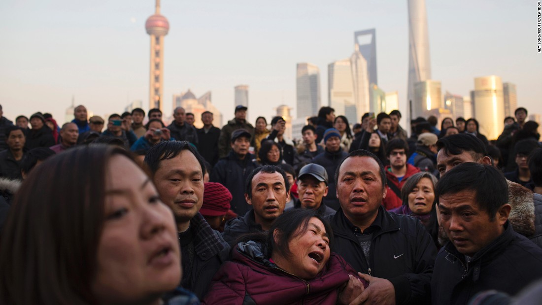 "A woman cries where <a href=""http://www.cnn.com/2015/01/02/world/asia/china-shanghai-new-years-stampede/index.html"" target=""_blank"">at least 36 people were killed in a stampede</a> during a New Year's celebration in Shanghai, China. The woman is the mother of one of the victims."
