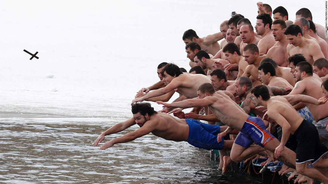 Men in Sofia, Bulgaria, jump into a lake as they try to grab a wooden cross on Epiphany Day, Tuesday, January 6. Orthodox priests throughout the country bless waters by throwing in a cross. It is strongly believed that catching the cross brings health and prosperity to the person who captures it.
