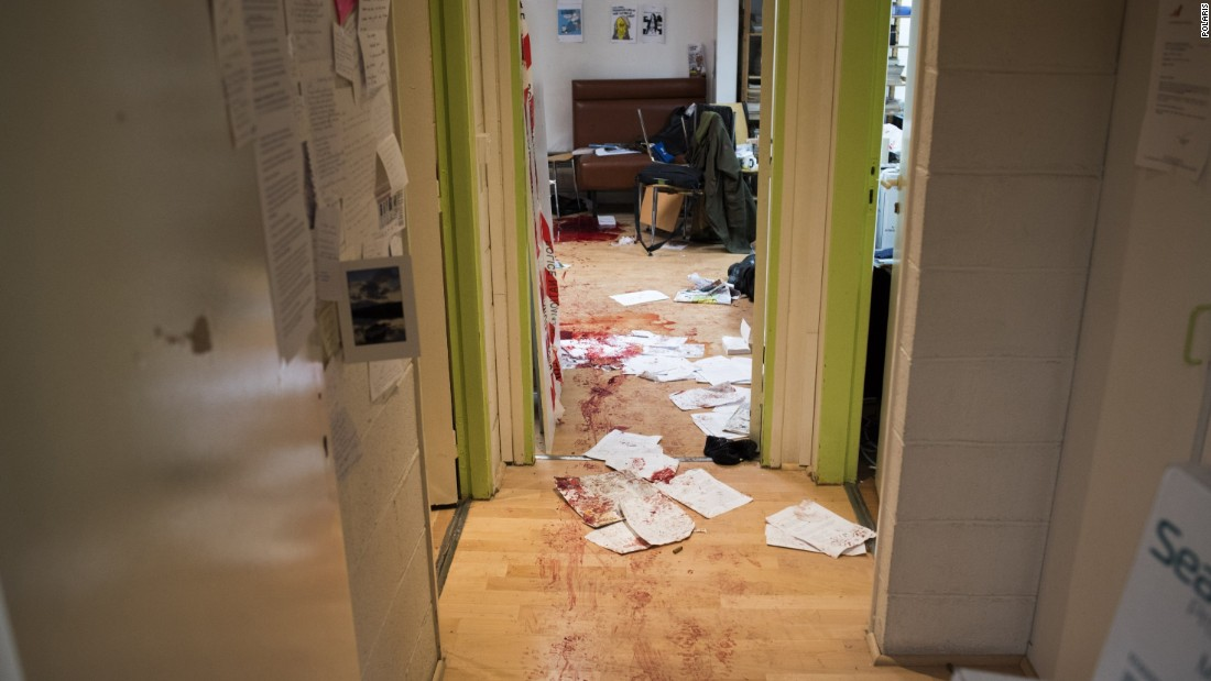Blood is seen on the floor and desks in the Charlie Hebdo newsroom on January 7.