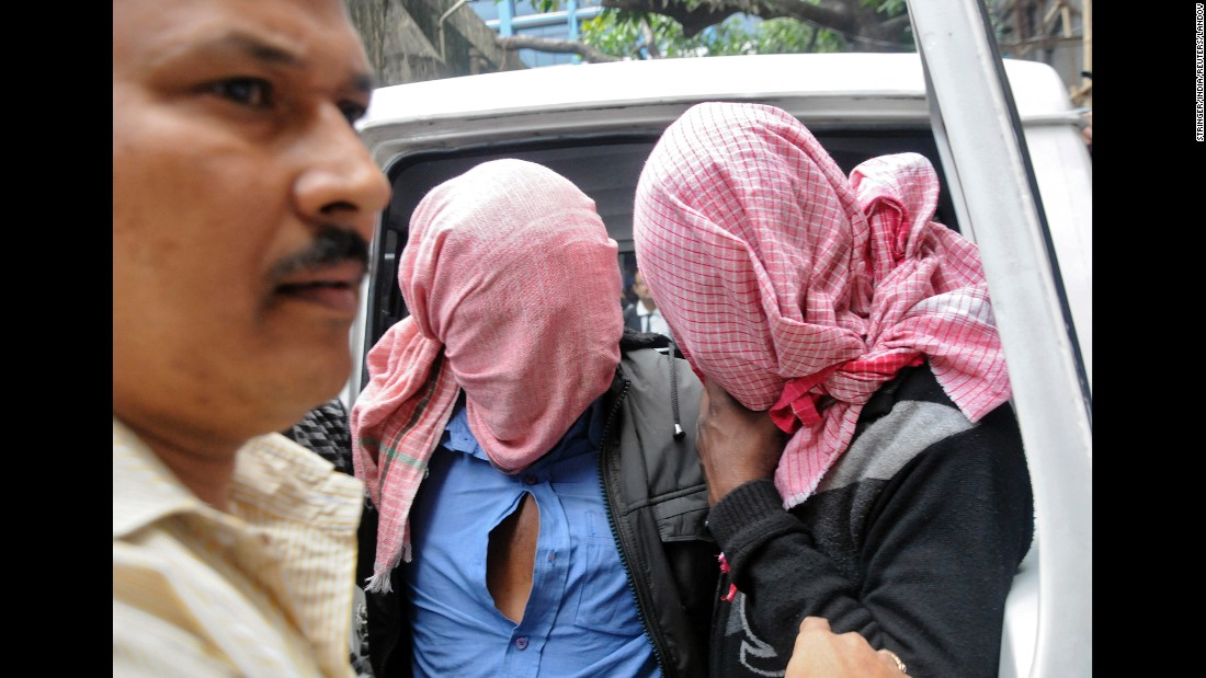 "A plainclothes policeman, left, escorts two men who were arrested in connection with the alleged abduction and gang rape of a Japanese tourist in Kolkata, India, on Saturday, January 3. <a href=""http://www.cnn.com/2015/01/04/asia/india-tourist-rape-accusations/index.html"" target=""_blank"">Five men were arrested in all. </a>"