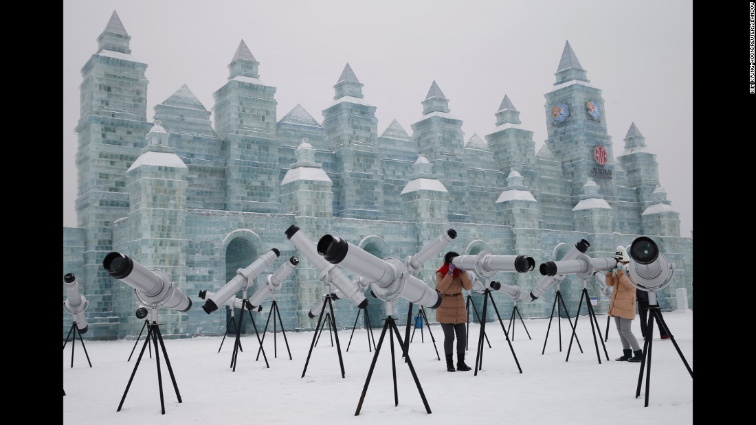 "Visitors use kaleidoscopes that are displayed with ice sculptures Sunday, January 4, ahead of the <a href=""http://www.cnn.com/2014/01/03/travel/harbin-ice-festival-2014/index.html"" target=""_blank"">Harbin Ice and Snow Festival</a> in Harbin, China."