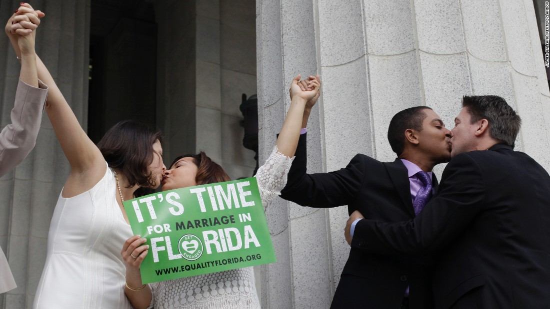From left, Catherina Pareto, Karla Arguello, Todd Delmay and Jeff Delmay kiss in Miami after getting married Monday, January 5. Florida had just become the 36th state to allow same-sex marriage.