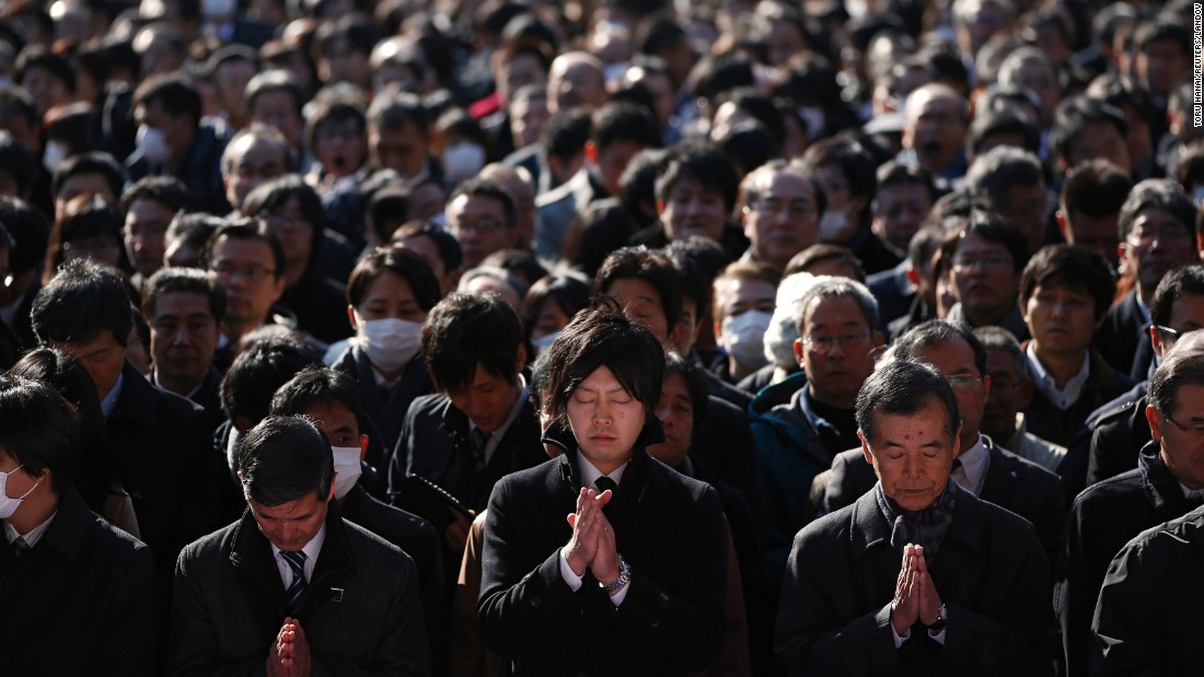 Businessmen offer prayers at the start of the new business year Monday, January 5, at the Kanda Myojin Shrine in Tokyo.