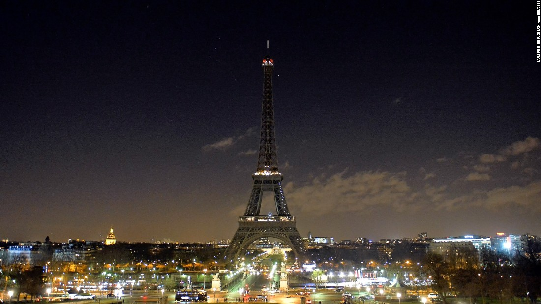 "The Eiffel Tower goes dark Thursday, January 8, in remembrance of the victims of the terrorist attack in Paris. A day earlier, <a href=""http://www.cnn.com/2015/01/07/world/gallery/paris-charlie-hebdo-shooting/index.html"" target=""_blank"">a shooting at the Paris office of satirical magazine Charlie Hebdo</a> left at least 12 people dead."