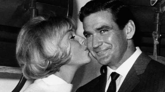 """Rod Taylor in 1965 on the set of the movie """"Do Not Disturb,"""" with co-star Doris Day."""