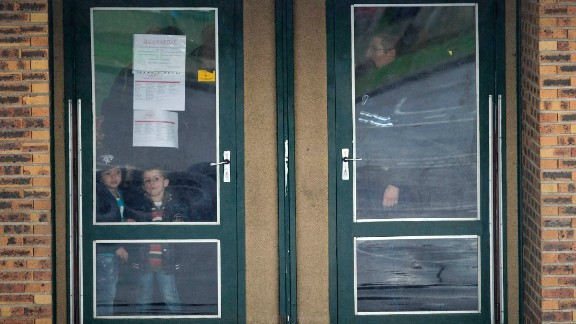 Children wait inside a school before being picked up by their parents. Dammartin-en-Goele residents were told to stay inside during the standoff, and schools were put on lockdown, the mayor's media office told CNN.