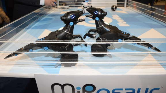 "MiPosaur reactive robots by WowWee respond to hand gestures and a ""Wowee ball,"" which uses an indoor GPS tracking system that causes the $119.99 robotic dinosaurs to react in different ways."