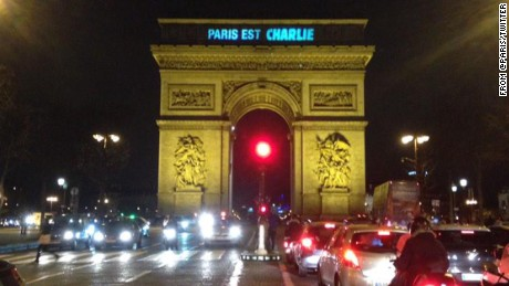 "The city of Paris tweeted this image showing the Arc de Triomphe with ""Paris est Charlie"" (Paris is Charlie) in lights."