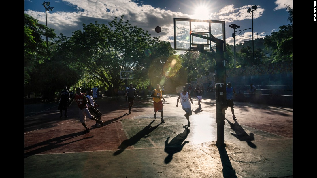 Men play basketball in the main square of the Petion-Ville district of Port-au-Prince.