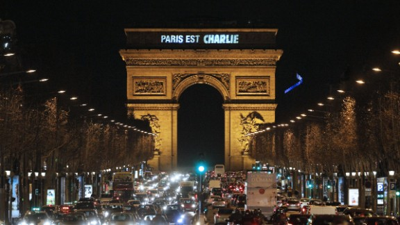 "Lights on the Arc de Triomphe say ""Paris est Charlie"" (Paris is Charlie) on January 9."