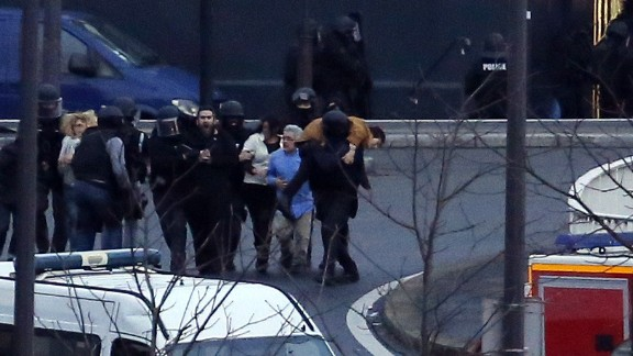 French police special forces evacuate the hostages after launching the assault at a kosher grocery store. THOMAS SAMSON/AFP/Getty Images)