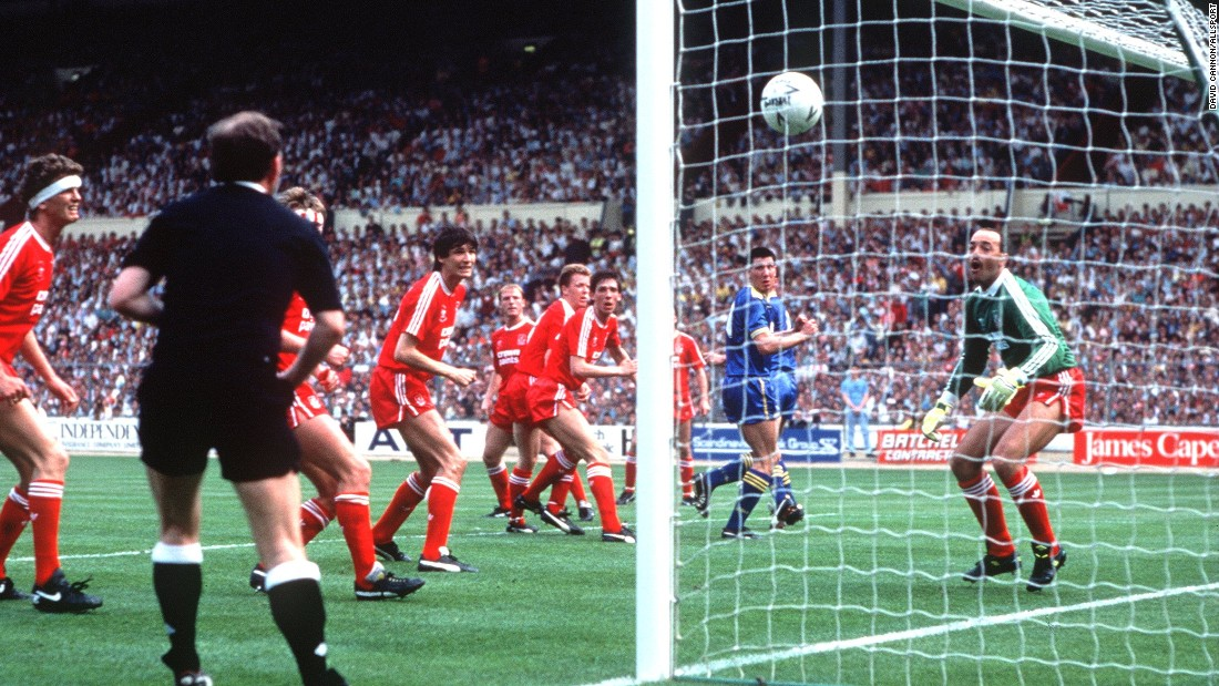 Unorthodox in the extreme, Wimbledon provided one of the great FA Cup final shocks when beating league champions Liverpool in 1988. Lawrie Sanchez (in blue) scored the only goal of the game.