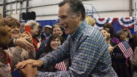 ANCHORAGE, AK - NOVEMBER 03: Former Massachusetts Gov. Mitt Romney greets the crowd during a rally for Republican Senate candidate Dan Sullivan at a PenAir airplane hangar on November 3, 2014 in Anchorage, Alaska. The U.S. Senate race in Alaska between incumbent Democratic Sen. Mark Begich and Republican candidate Dan Sullivan continues to be closely contested. (Photo by David Ryder/Getty Images)