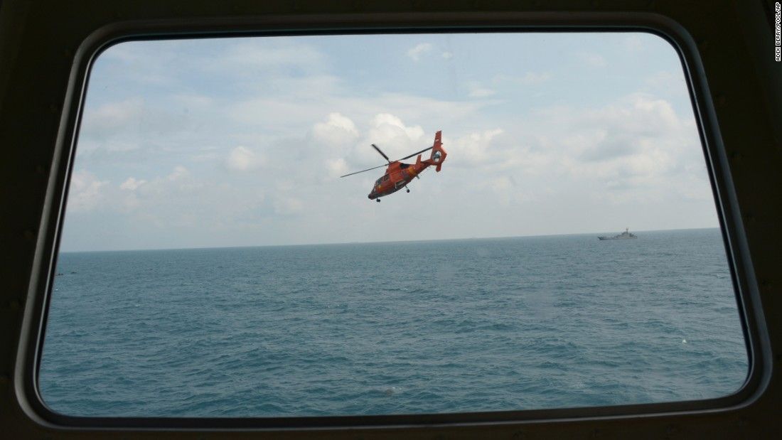 An Indonesian rescue helicopter flies during search operations in the Java Sea on Friday, January 9.