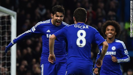 Diego Costa and Oscar celebrate as Chelsea defeat Newcastle United at Stamford Bridge.