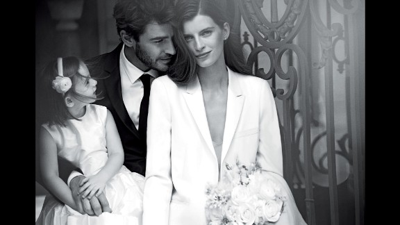 The campaign includes an image of a couple on their wedding day with their child, a nod to couples having children outside marriage.