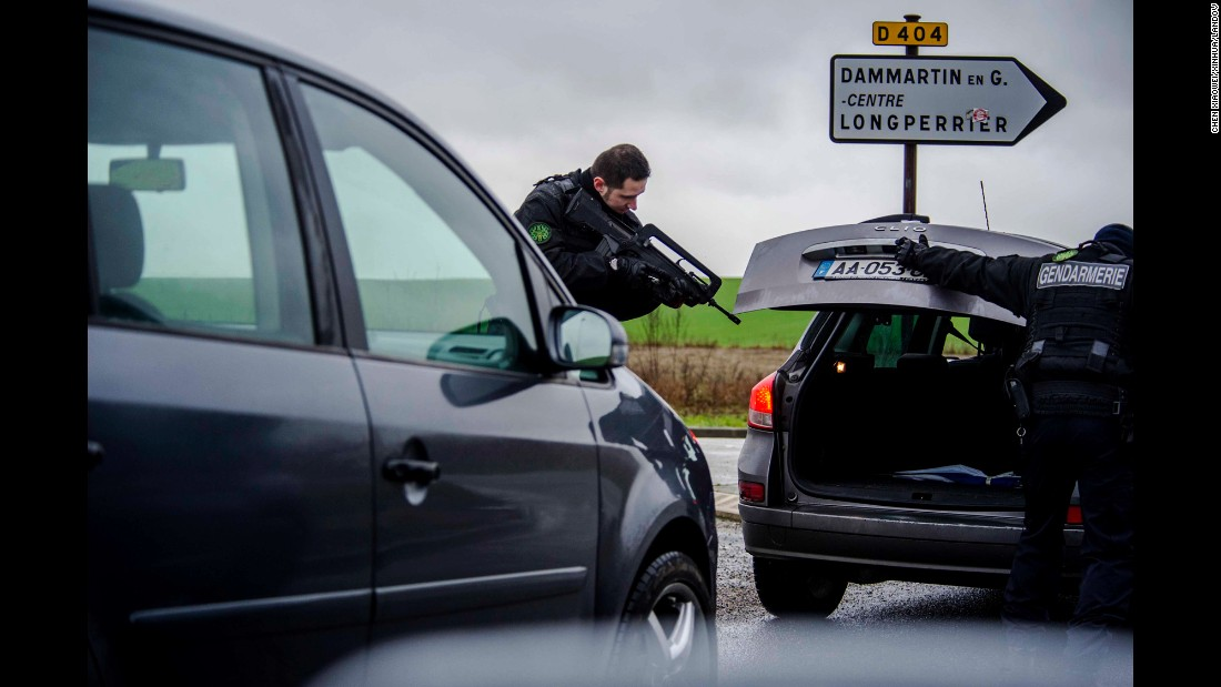 A police officer checks a car in Dammartin-en-Goele.