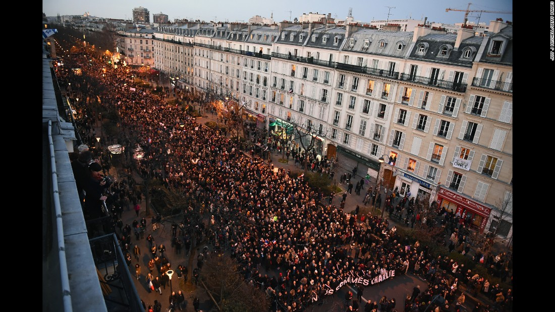 "People march down Boulevard Voltaire from the Place de la Republique to the Place de la Nation in Paris on Sunday, January 11. An estimated 1.5 million people joined world leaders in the ""unity rally."""