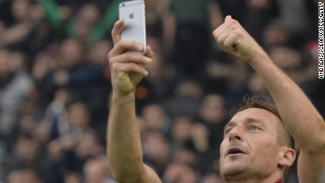 Francesco Totti takes a 'selfie' after scoring his second and the equalizer against Lazio in the Olympic Stadium.