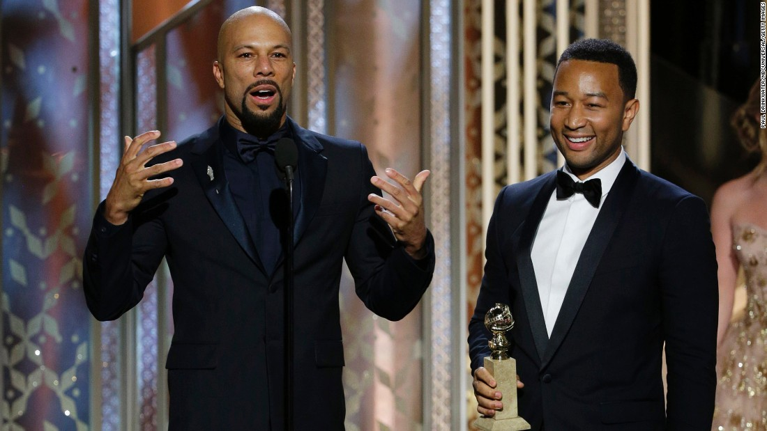 "Common, left, and John Legend accept the award for their song ""Glory"" from the movie ""Selma."""
