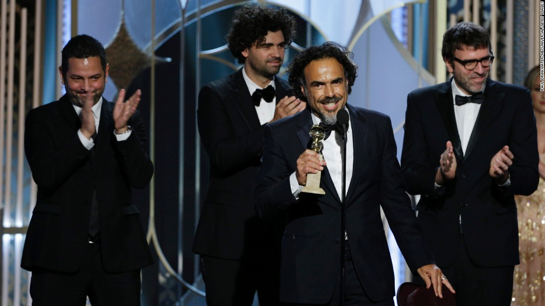 "Alejandro Gonzalez Inarritu accepts the best screenplay award for ""Birdman."" Michael Keaton, the star of the film, also won a Golden Globe for best actor in a musical or comedy."