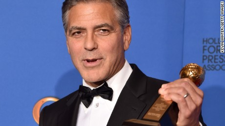 Caption:BEVERLY HILLS, CA - JANUARY 11: Actor/director George Clooney, recipient of the Cecil B. DeMille Award, poses in the press room during the 72nd Annual Golden Globe Awards at The Beverly Hilton Hotel on January 11, 2015 in Beverly Hills, California. (Photo by Kevin Winter/Getty Images)