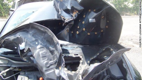"The Louisiana Attorney General says this car had what it calls an ""aftermarket"" hood part, and when the car was in a wreck, the hood crumpled in a way it should not have."