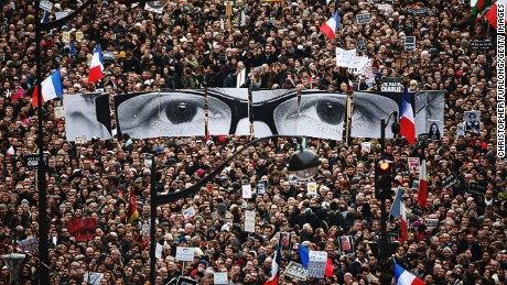 Demonstrators make their way along boulevard Voltaire in Paris during a unity rallyon Sunday following the recent terrorist attacks. An estimated one million people took part.