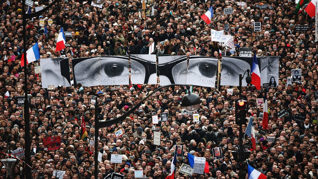 "JANUARY 12 - PARIS, FRANCE: Demonstrators make their way along Boulevard Voltaire in a unity rally following the recent terrorist attacks.<a href=""http://cnn.com/2015/01/11/world/charlie-hebdo-paris-march/index.html""> At least 3.7 million people</a> took part and <a href=""http://cnn.com/2015/01/11/politics/obama-kerry-paris/index.html"">French President Francois Hollande was joined by world leaders</a> such as British PM David Cameron, Israeli PM Benjamin Netanyahu, German Chancellor Angela Merkel, Palestinian Authority President Mahmoud Abbas and Russian Foreign Minister Sergey Lavrov."