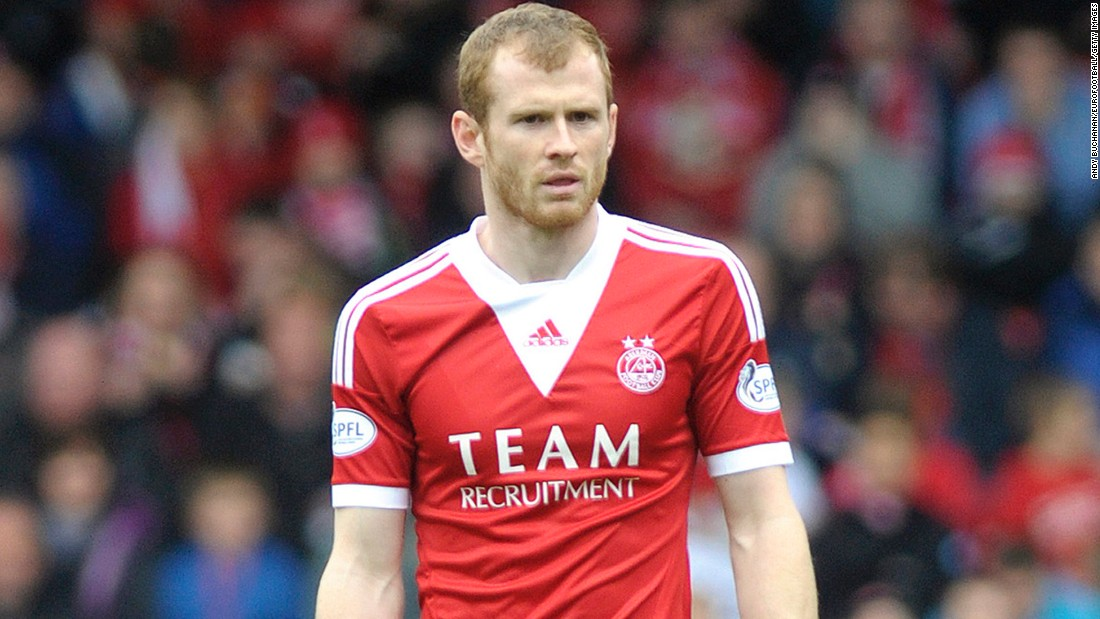 Mark Reynolds won his first domestic trophy as Aberdeen lifted the 2014 Scottish League Cup - their first silverware for 19 years.