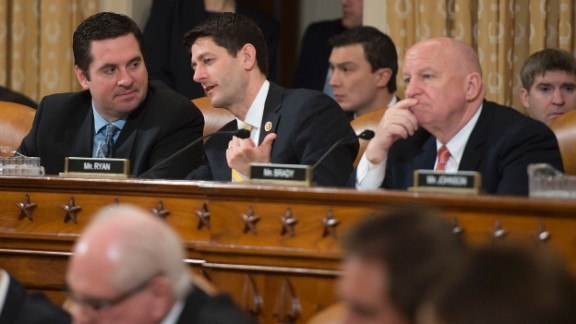 Ryan, center, speaks with Rep. Devin Nunes, R-California, before a House Ways and Means Committee meeting on March 12, 2014.