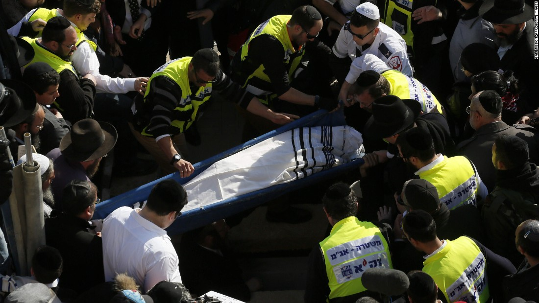Mourners carry Hattab's body in Jerusalem on January 13.