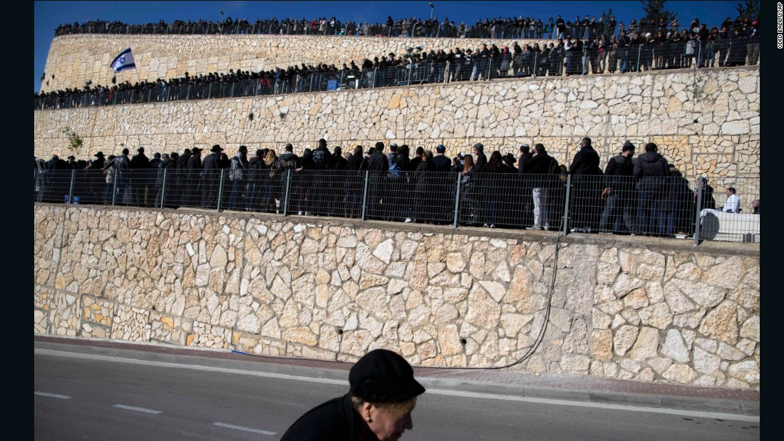 People attend the funeral service in Jerusalem on January 13.