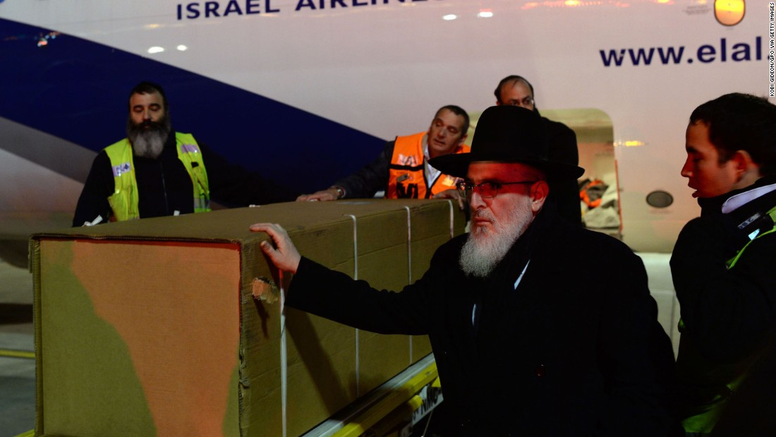 The coffins of the four victims arrive at Ben Gurion airport on the morning of January 13 in Tel Aviv.