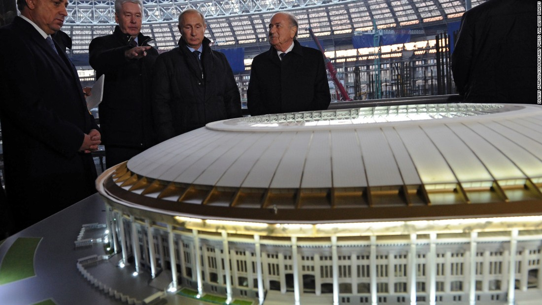 President Putin with Fifa officials. The 2018 World Cup could mean enormous profits for international contractors.