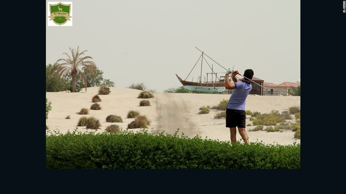 A player takes aim on the Al Ghazal course in Abu Dhabi, regarded by some experts as a world class sand course.