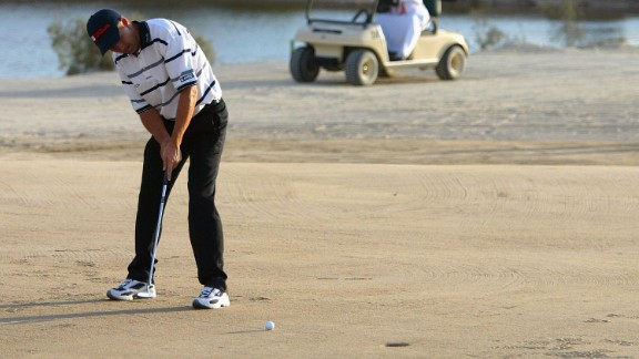 Here, Padraig Harrington of Ireland putts on the 17th hole during the Abu Dhabi World Sand Golf Championships at the Al Ghazal Golf Club in 2004.