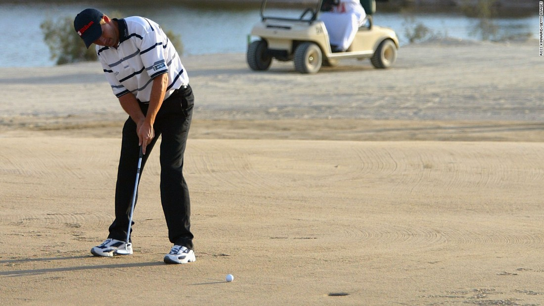 Padraig Harrington of Ireland putts on the 17th hole during the Abu Dhabi World Sand Golf Championships at Al Ghazal in 2004.