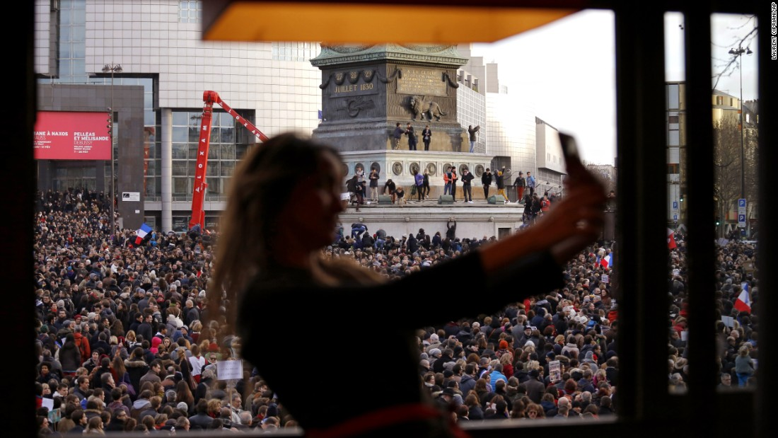 "A woman takes a selfie in Paris' Bastille Square as a crowd gathers for a <a href=""http://www.cnn.com/2015/01/11/world/gallery/paris-unity-rally/index.html"" target=""_blank"">""unity rally""</a> on Sunday, January 11. More than a million people attended the rally, which took place days after Islamic extremists killed 17 people in the country."