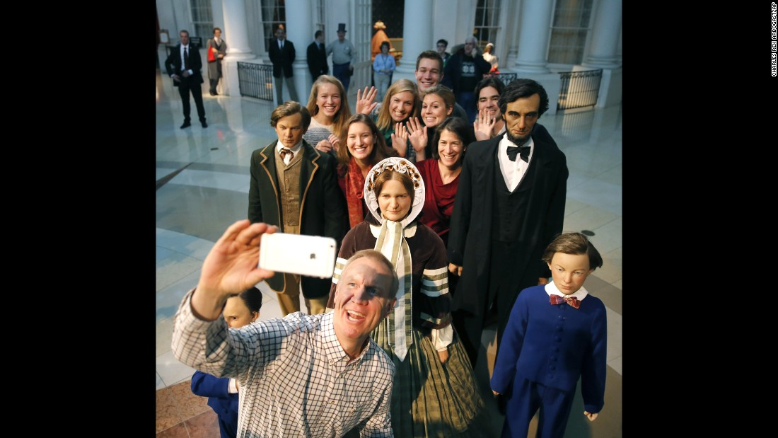 Bruce Rauner, Illinois's governor-elect, takes a selfie Sunday, January 11, with his family and some statues at the Abraham Lincoln Museum in Springfield, Illinois. He was inaugurated a day later.