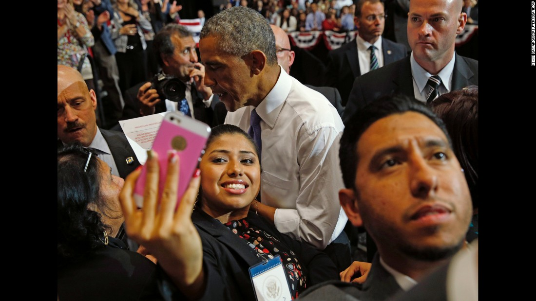 A young woman in Phoenix holds up her phone to get a selfie with U.S. President Barack Obama on Thursday, January 8. Obama had just given a speech about the housing market.