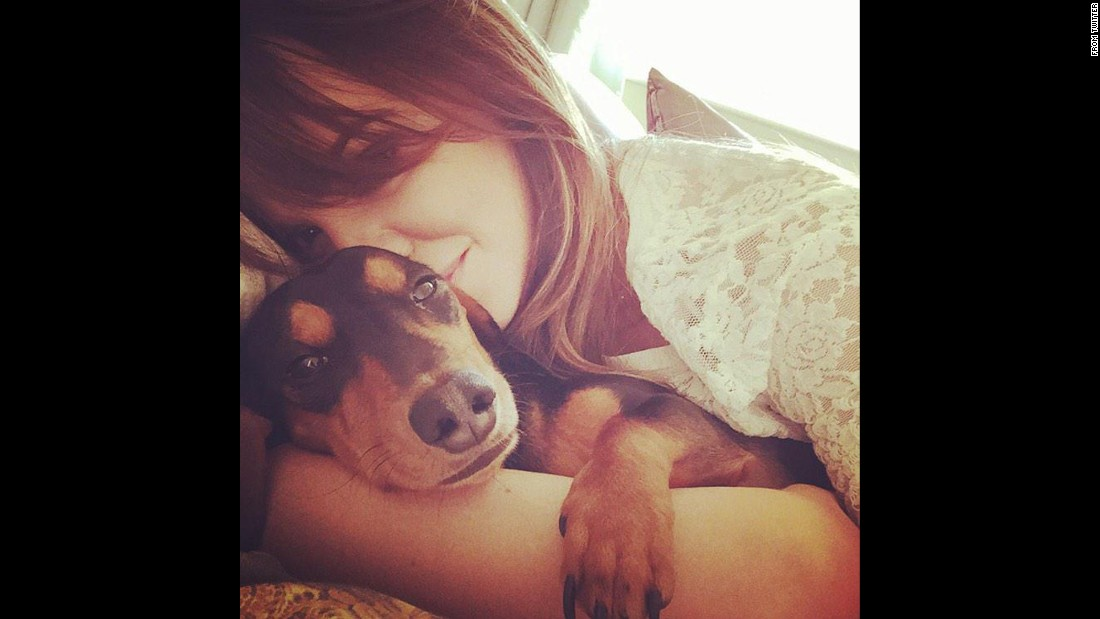 "Model Maria Fowler snuggles with a dog in <a href=""https://twitter.com/MariaFowler/status/552886855986081796/photo/1"" target=""_blank"">this tweet</a> she sent on Wednesday, January 7."