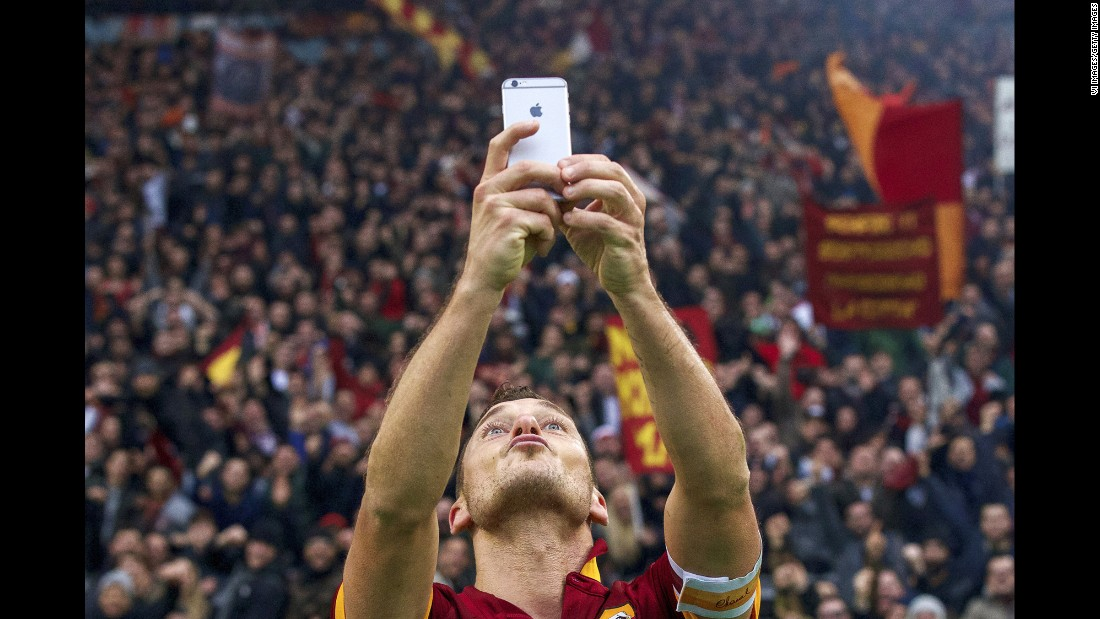 "Soccer star Francesco Totti snaps a selfie after he scored a goal for Roma during an Italian league match Sunday, January 11, in Rome. <a href=""http://www.cnn.com/2015/01/11/football/totti-selfie-roma-lazio/"" target=""_blank"">Totti's celebration</a> came after his second goal of the game, which tied rivals Lazio at 2-2. The match ended in the same score."