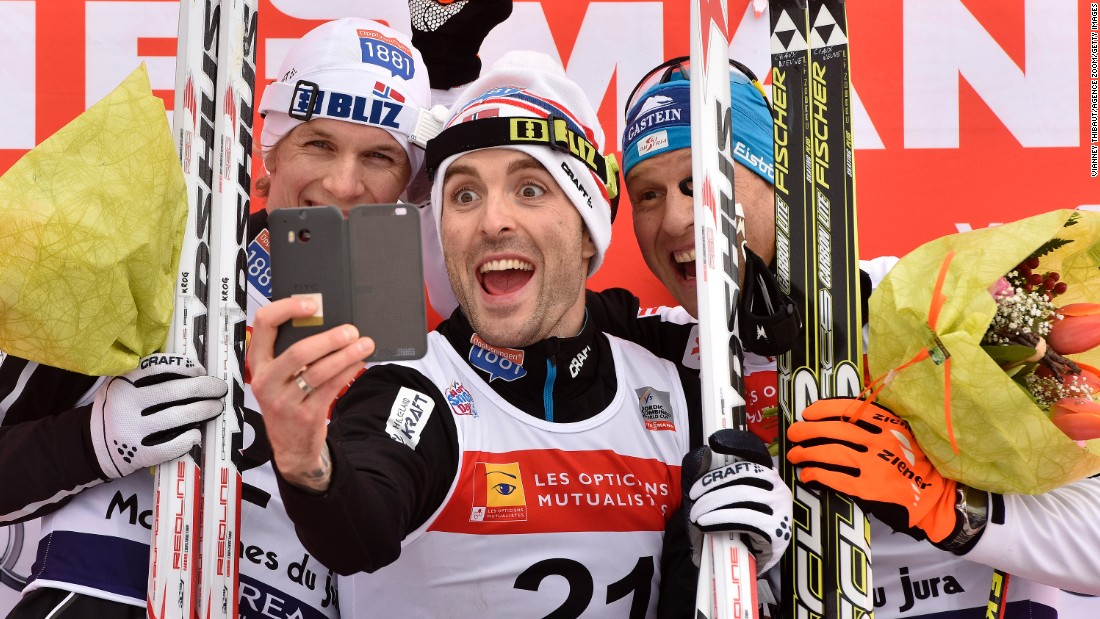From left, skiers Magnus Krog, Magnus Hovdal Moan and Bernhard Gruber take a selfie on the podium after a Nordic combined race Sunday, January 11, in Chaux-Neuve, France.
